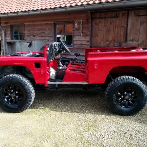 1992 LR LHD Defender 90 Red 200 Tdi A day 1 left side