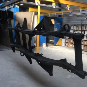 Blasted chassis being powdercoated