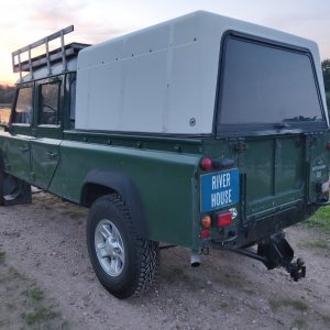 1995 LR LHD Defender 130 Conisten Green left rear