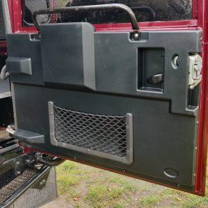 1995 LR LHD Defender 110 Montalcino Red rear door card