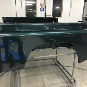 1995 LR LHD Defender 90 300 tdi painter rear tub capping installed before final coat