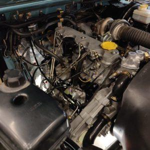 1992 LR LHD Defender 110 Tdi Riviera Blue B engine bay 2