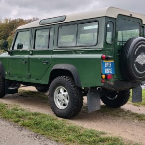 1995 LR LHD Defender 110 Conisten Green 300 Tdi left rear