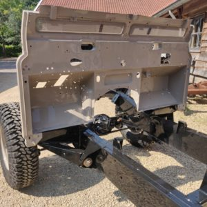 1992 LR LHD Defender 110 5 dr Tdi Cappuchino chassis rolling with bulkhead close up
