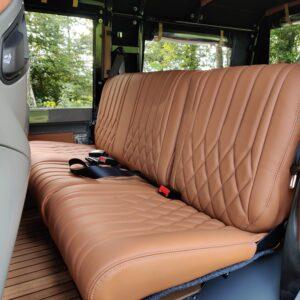 2003 LR LHD Defender 110 Td5 Soft Top Grey A 2nd row seat Bugatti stitch