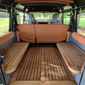 2003 LR LHD Defender 110 Td5 Soft Top Grey A teak benches and floor MID