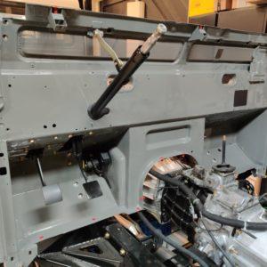 2003 LR LHD Defender 110 Td5 Soft Top Grey building 2 bulkhead inside