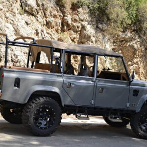 2003 LR LHD Defender 110 Td5 Soft Top Grey in Spain mountain right side