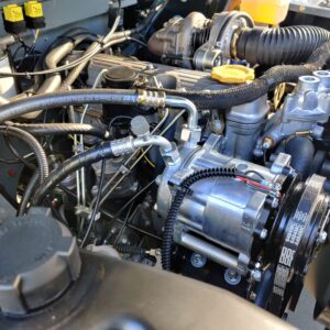 1993 LR LHD Defender 130 day 57 engine bay with AC right