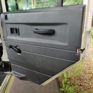 1995 LR LHD Defender 110 White 300 Tdi interior 2nd row door right