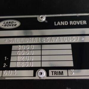2004 LR LHD Defender 110 High Cap VIN plate on booster