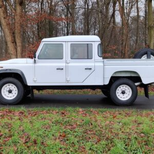 2010 LHD LR Defender 130 White Tdci left side