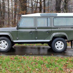 1996 LR Defender 110 300 Tdi Dark Green A left side