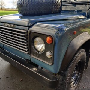 1995 LR LHD Defender 130 Stationwagon Arles Blue grill close left