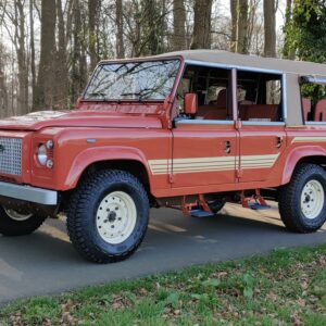 2001 LR LHD Defender 110 Coral Orange B half open left front
