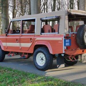 2001 LR LHD Defender 110 Coral Orange B half open left rear
