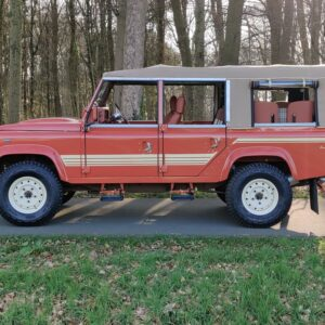 2001 LR LHD Defender 110 Coral Orange B half open left side