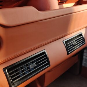 2001 LR LHD Defender 110 Coral Orange B half open underdash AC trimmed in leather
