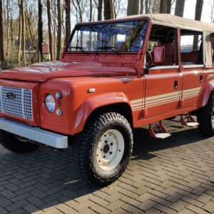 2001 LR LHD Defender 110 Coral Orange C half open left front