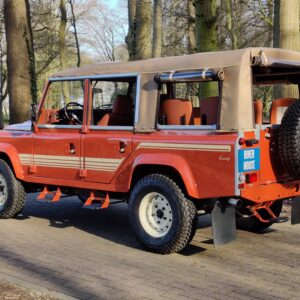 2001 LR LHD Defender 110 Coral Orange C half open left rear
