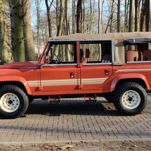 2001 LR LHD Defender 110 Coral Orange C half open left side