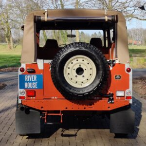 2001 LR LHD Defender 110 Coral Orange C half open rear