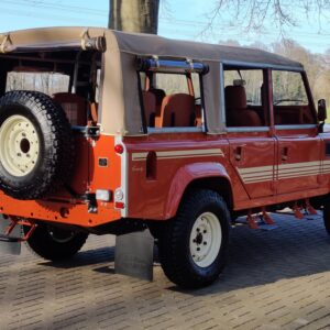 2001 LR LHD Defender 110 Coral Orange C half open right rear