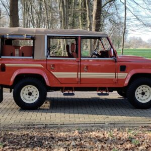 2001 LR LHD Defender 110 Coral Orange C half open right side