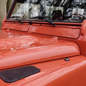 2001 LR LHD Defender 110 Coral Orange Soft Top PUMA bonnet