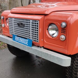 2001 LR LHD Defender 110 Coral Orange Soft Top grill close