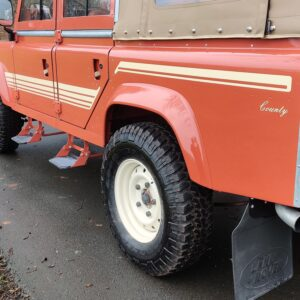 2001 LR LHD Defender 110 Coral Orange Soft Top left body