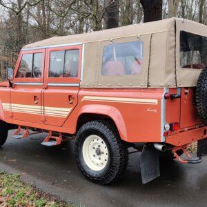 2001 LR LHD Defender 110 Coral Orange Soft Top left rear